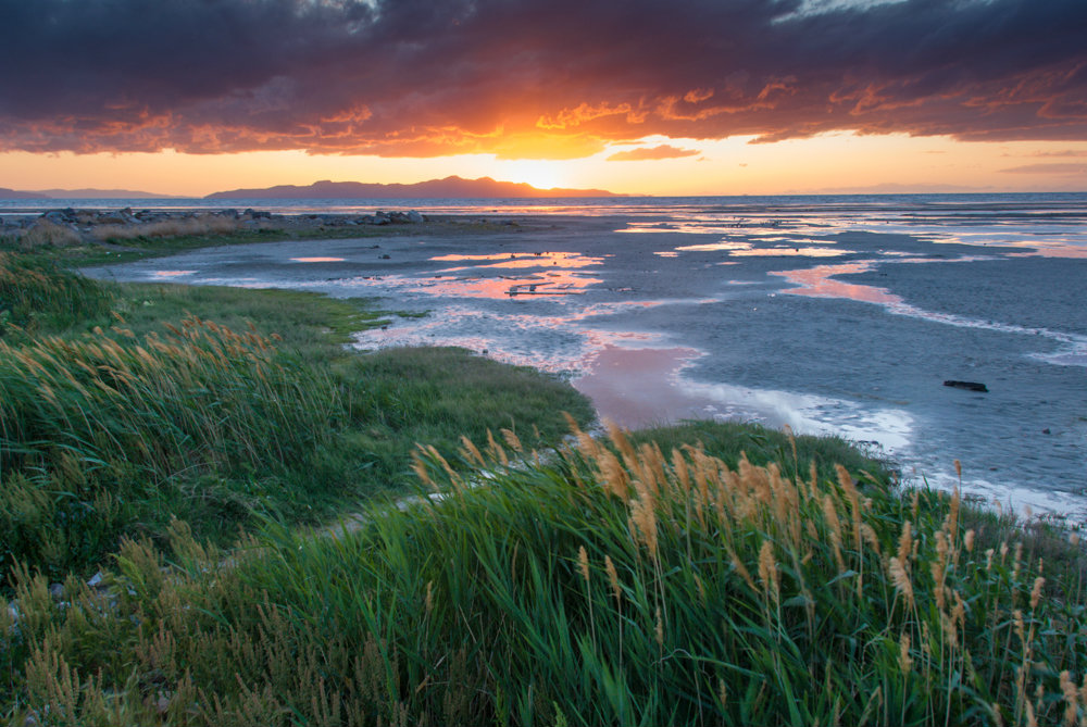 """Sunset Heard Round The World by <a href=""""http://greatsaltlakephotography.com"""">Charles Uibel</a>"""